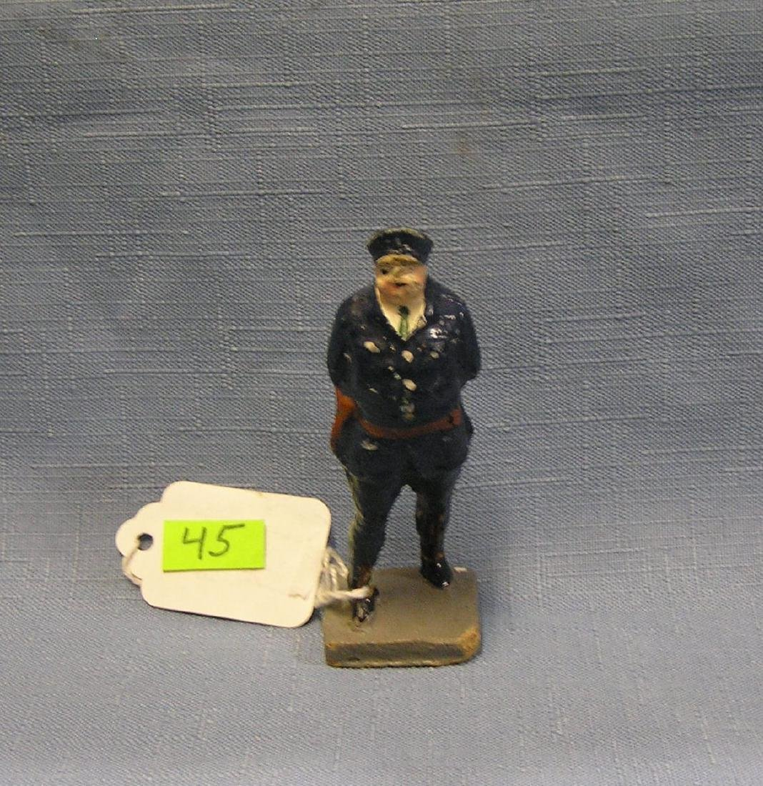 Early hand painted composition policeman figure