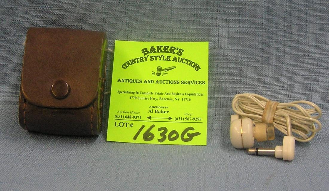 Pair of vintage ear plugs in original leather case