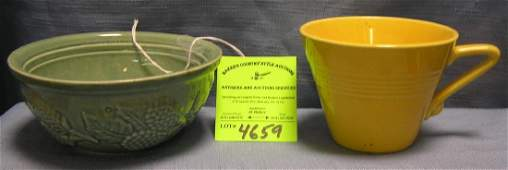 Art pottery featuring decorated bowl and yellow cup