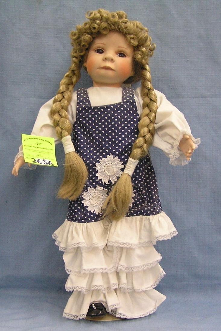 Vintage porcelain doll with pig tails