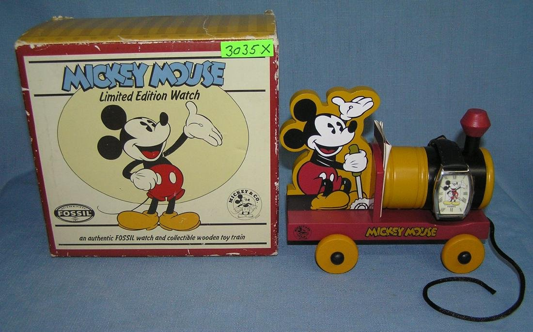 Mickey Mouse Fossil wrist watch and wood train