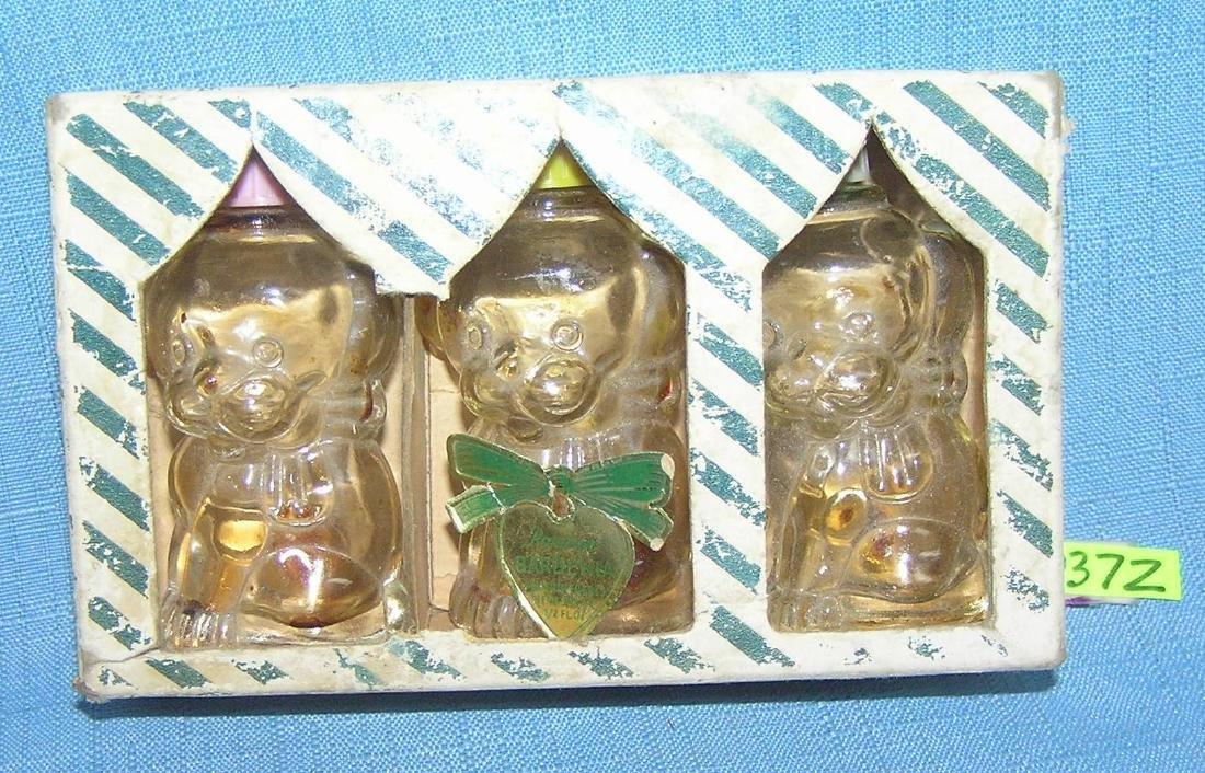 Group of 3 vintage puppy dog perfume bottles
