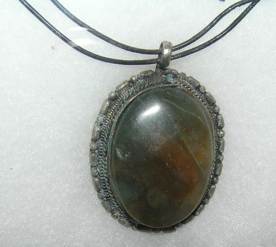 Natural stone necklace in cast metal holder