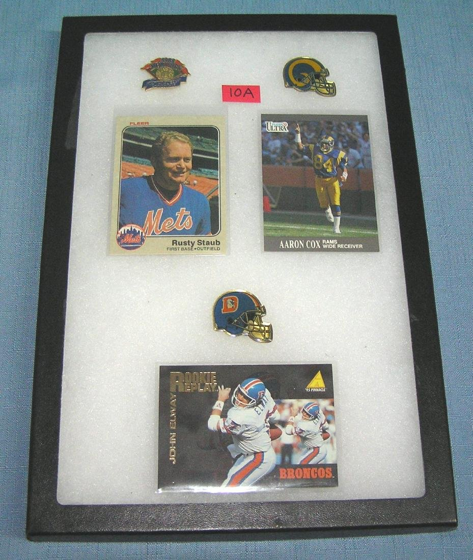 Collection of baseball and football pins and cards