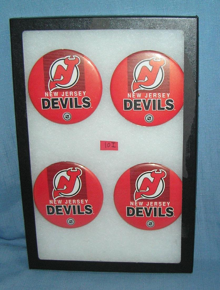 Group of vintage NHL NJ Devils hockey pin back buttons
