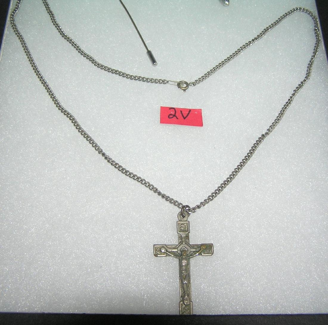 Silver tone religious necklace featuring Jesus on the