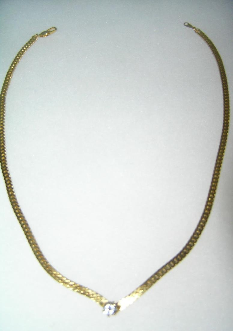 Quality gold tone necklace with simulated diamond stone
