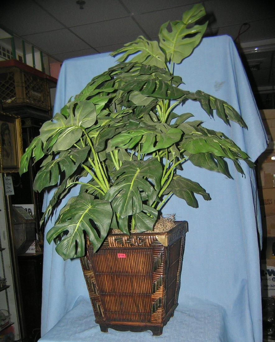 Artificial plant in a bamboo style planter