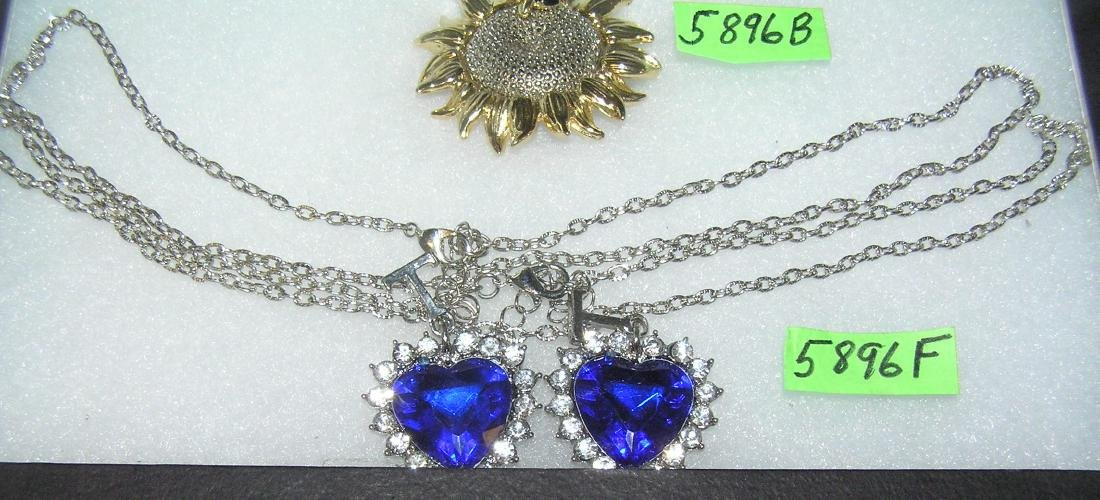 Pair of cobalt blue colored heart shaped necklaces