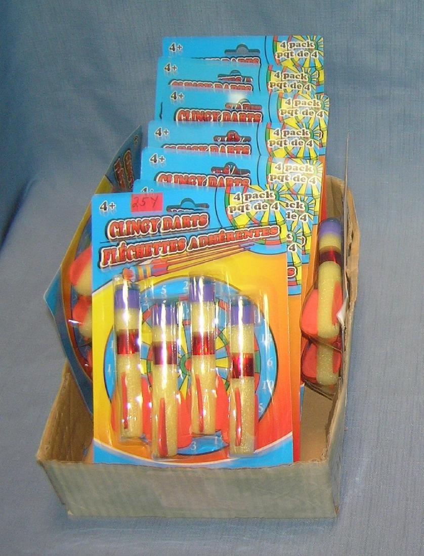Box full of clingy dart toys