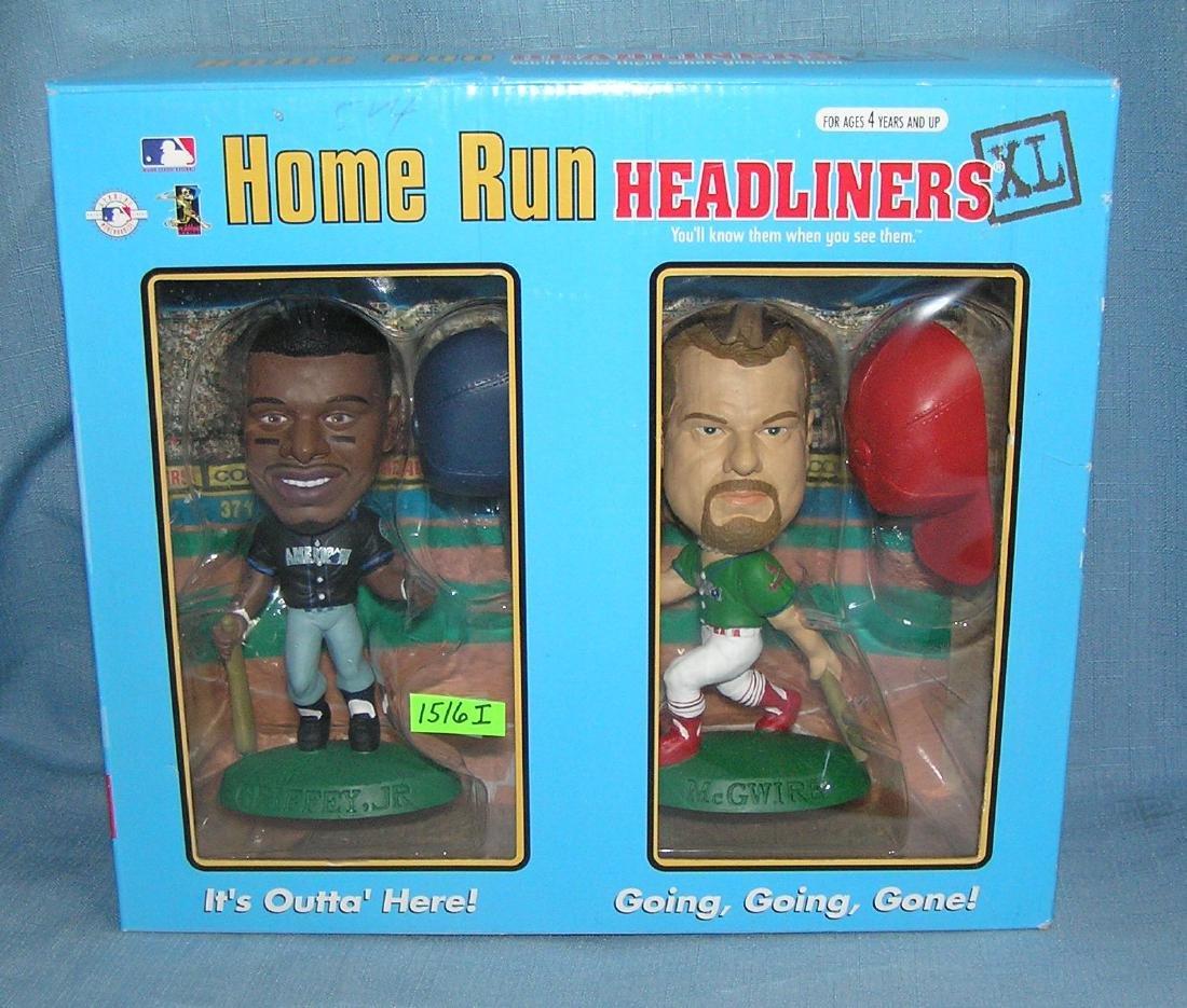 K. Griffey Jr. and M. McGwire bobble head dolls