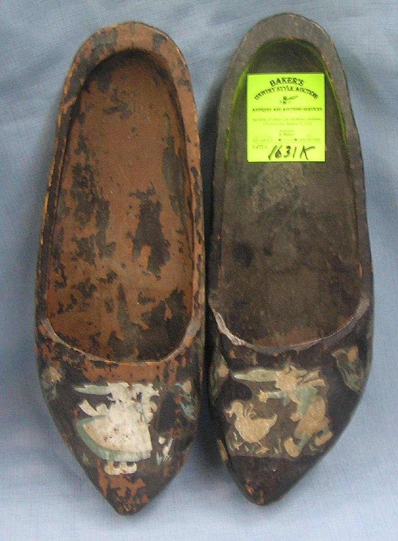 Pair of stencil decorated wooden shoes