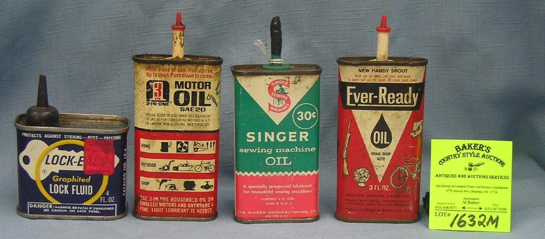 Group of four vintage oil tins including Singer