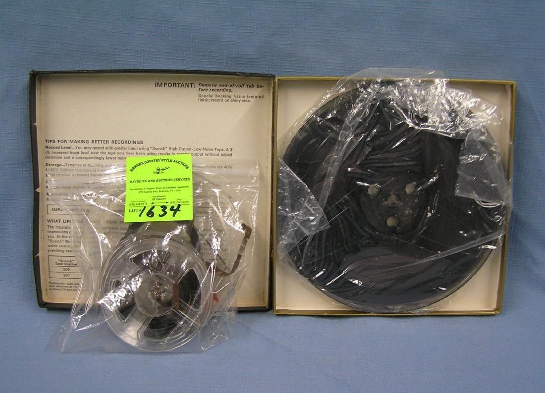 Group of vintage reel to reel reels and tapes