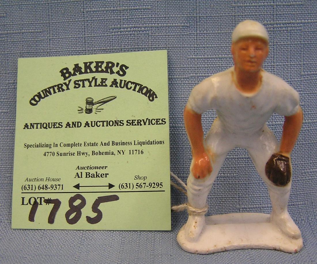 Miniature hard plastic baseball player