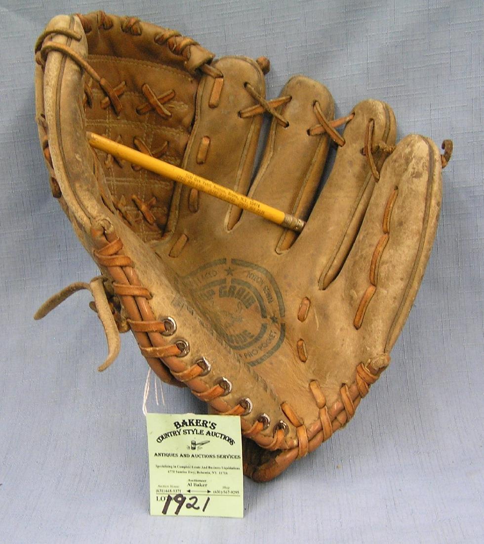 Vintage leather baseball glove: the backhanded