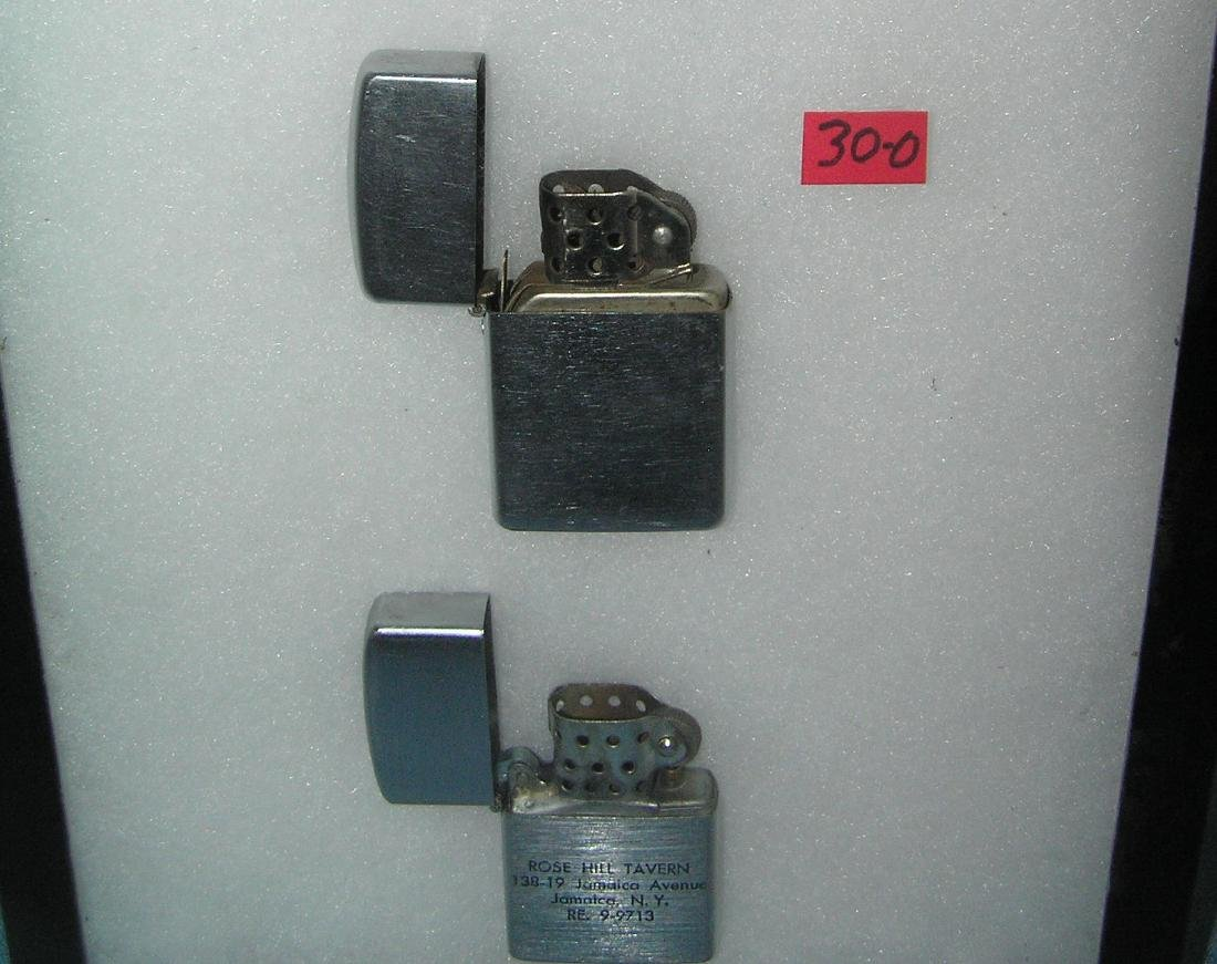 Collection of vintage lighters includes Zippo - 2