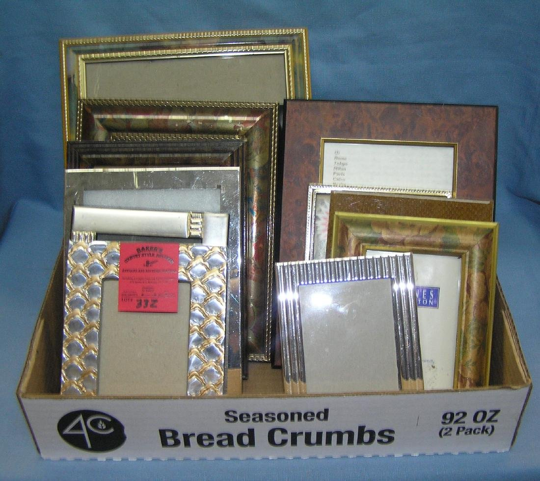 Box full of vintage and modern picture frames