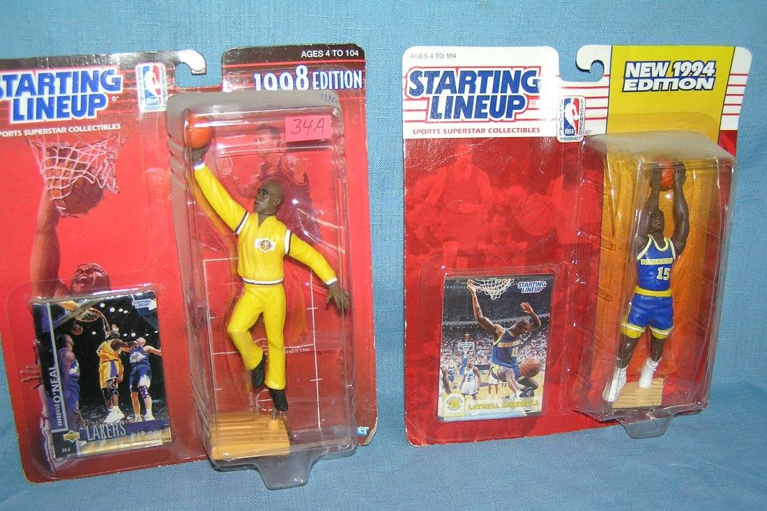 Pair of vintage basketball starting lineup sports