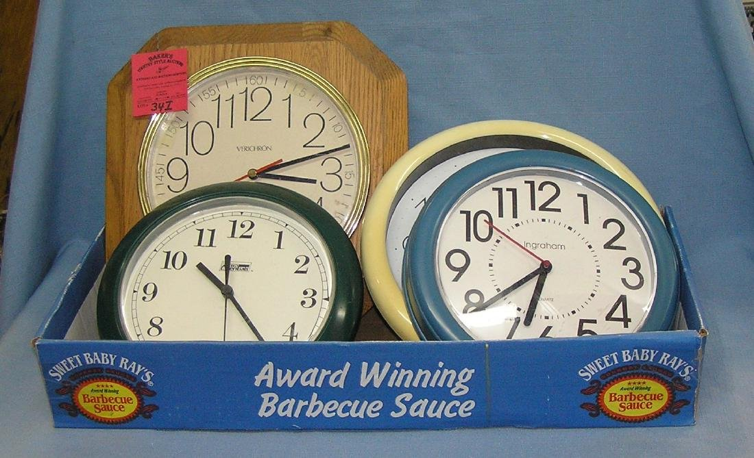 Box full of wall clocks