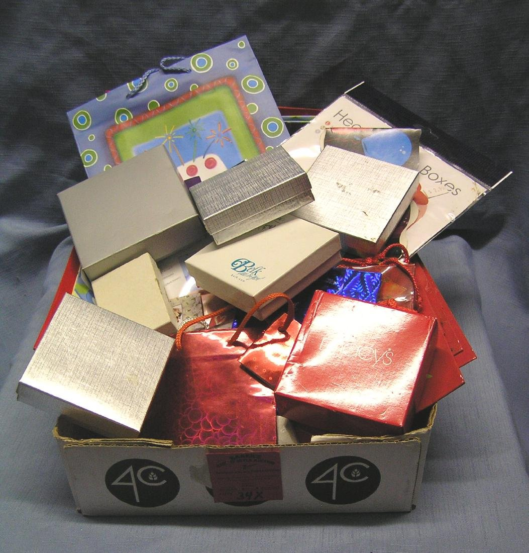 Box full of gift bags, jewelry boxes, party supplies