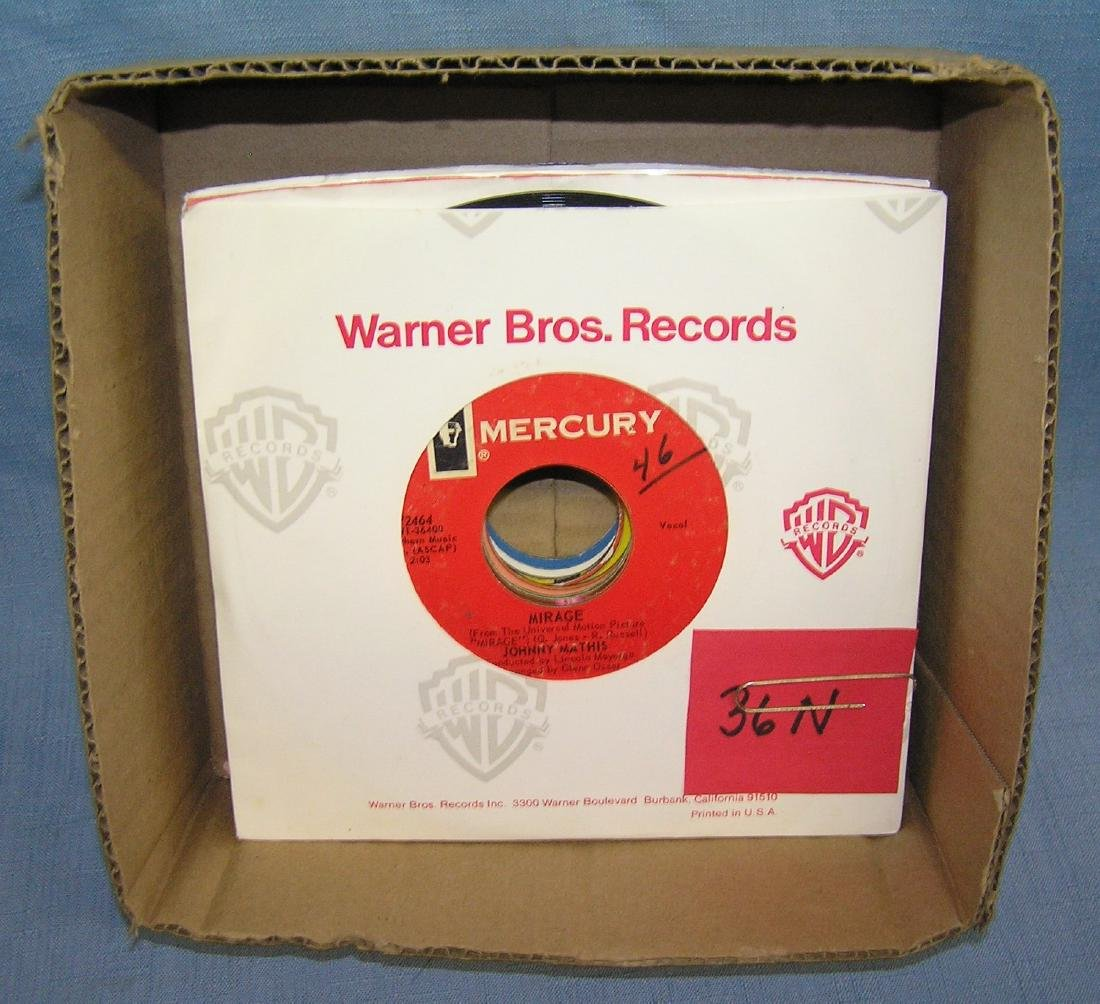 Box of vintage 45 RPM records