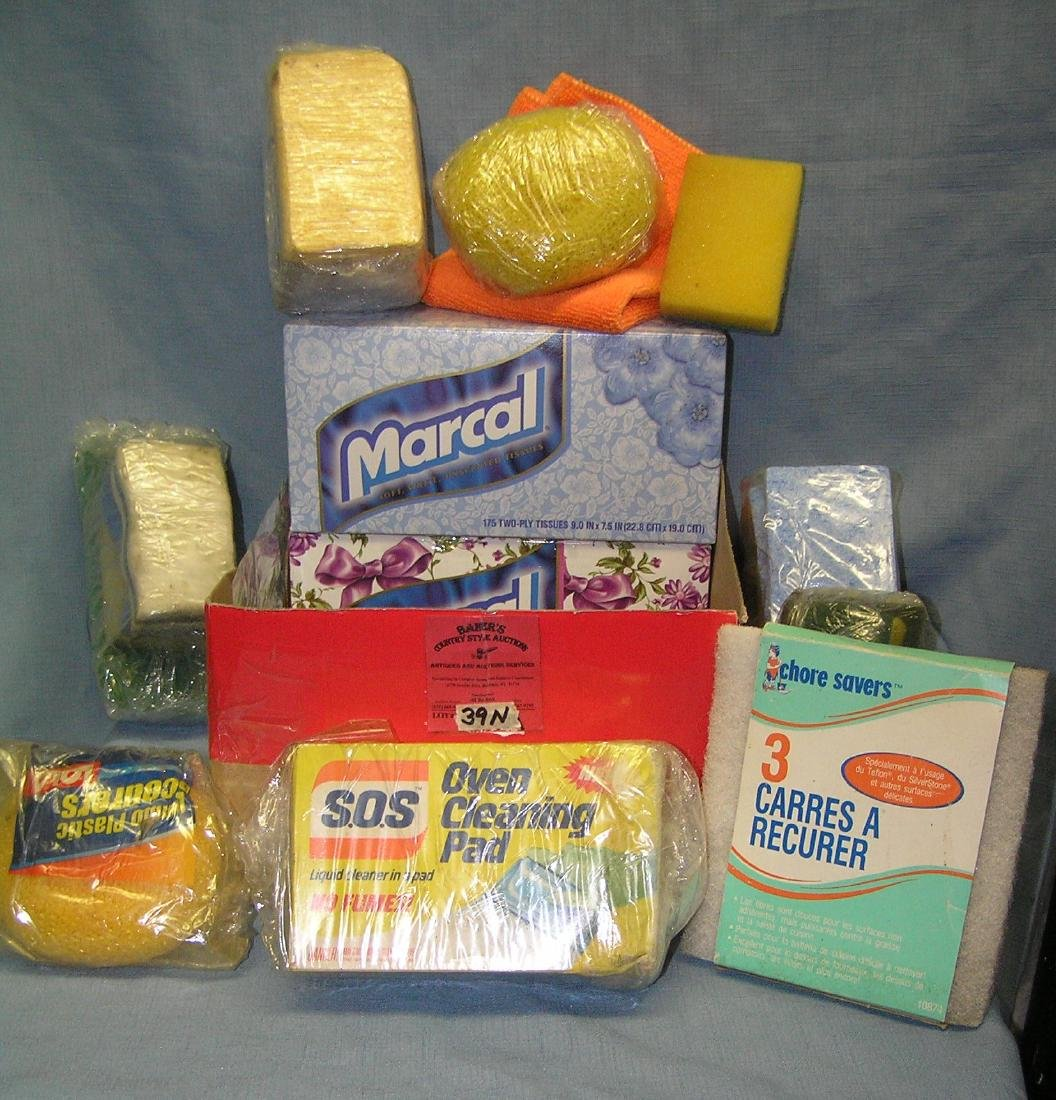 Box full of cleaning pads, sponges and more