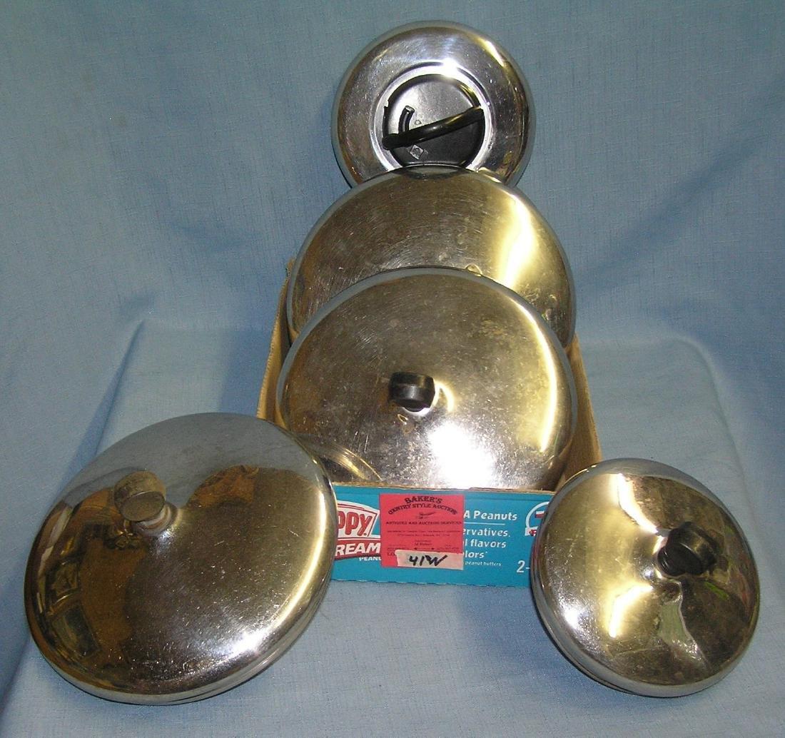Box full of stainless steel pot lids