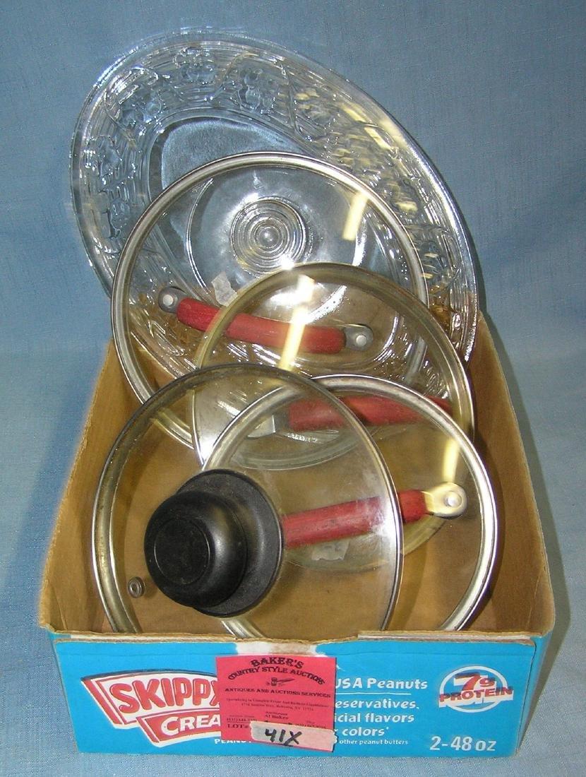 Box full of glass pot lids