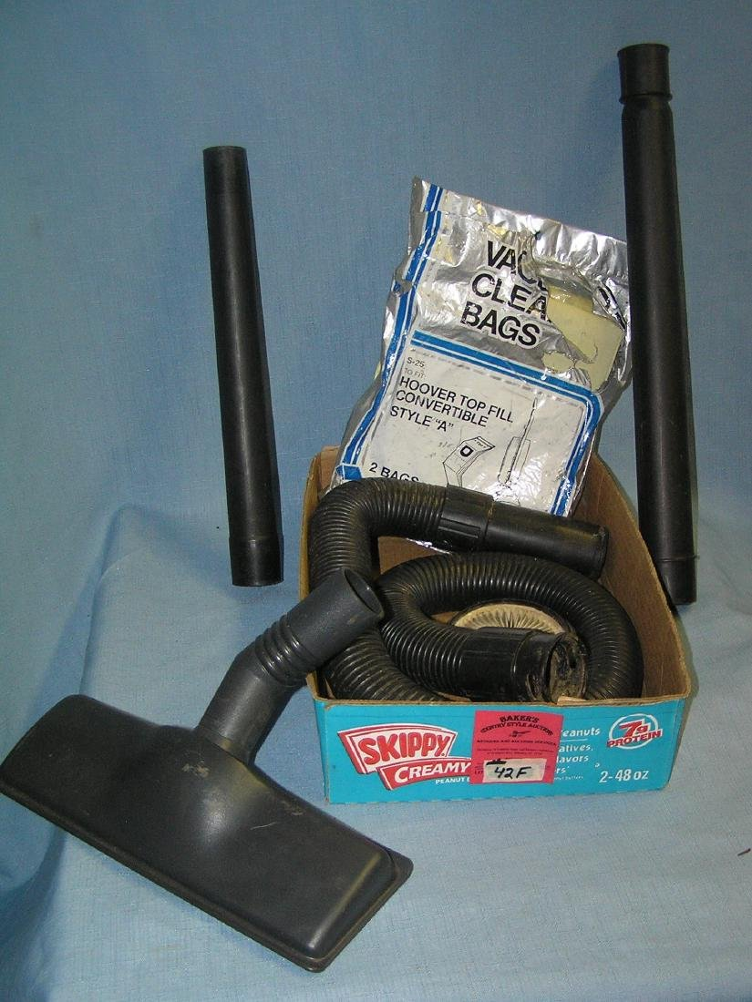 Box full of vacuum cleaner parts and accessories