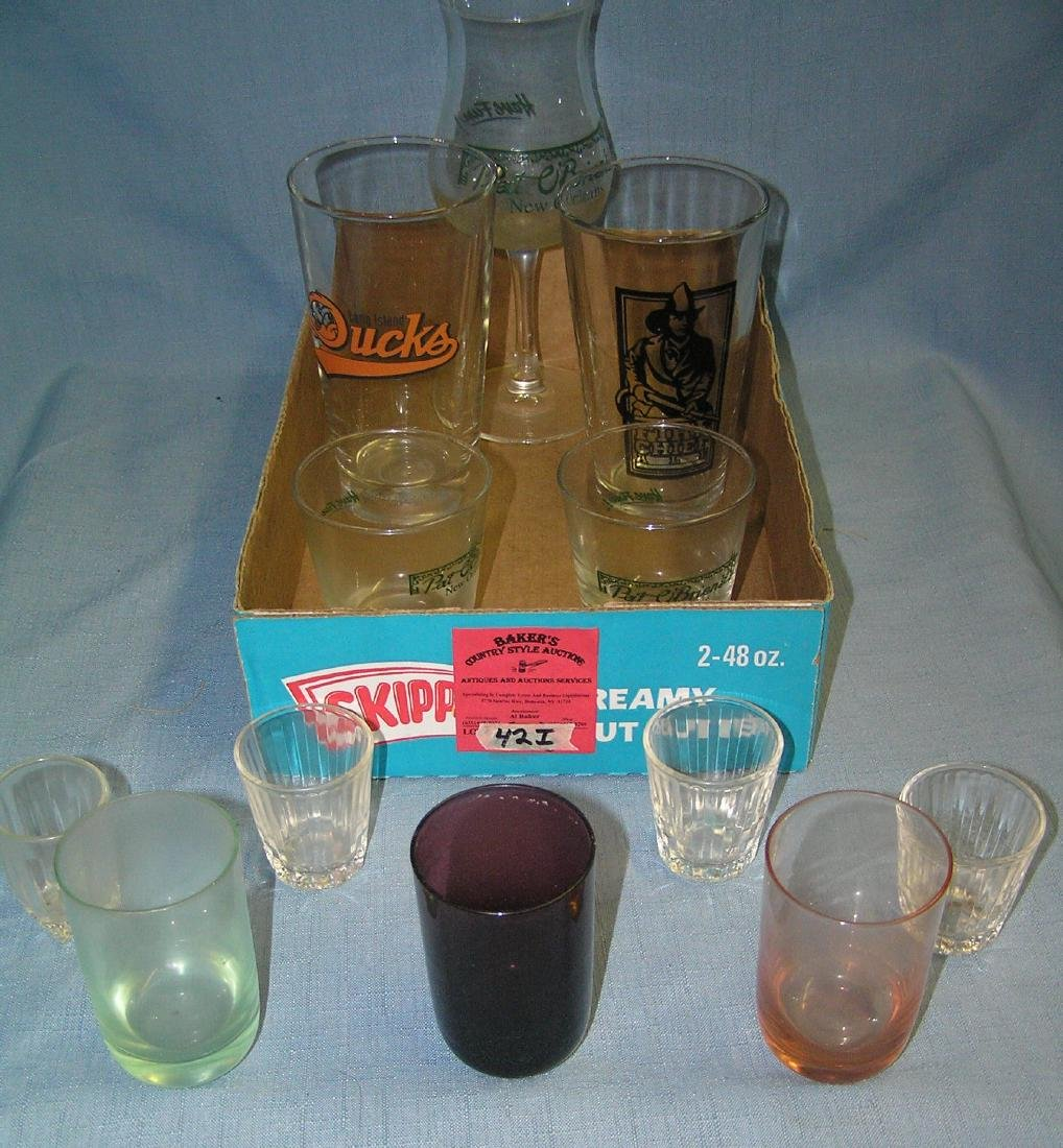 Box full of vintage shot, drink and beer glasses