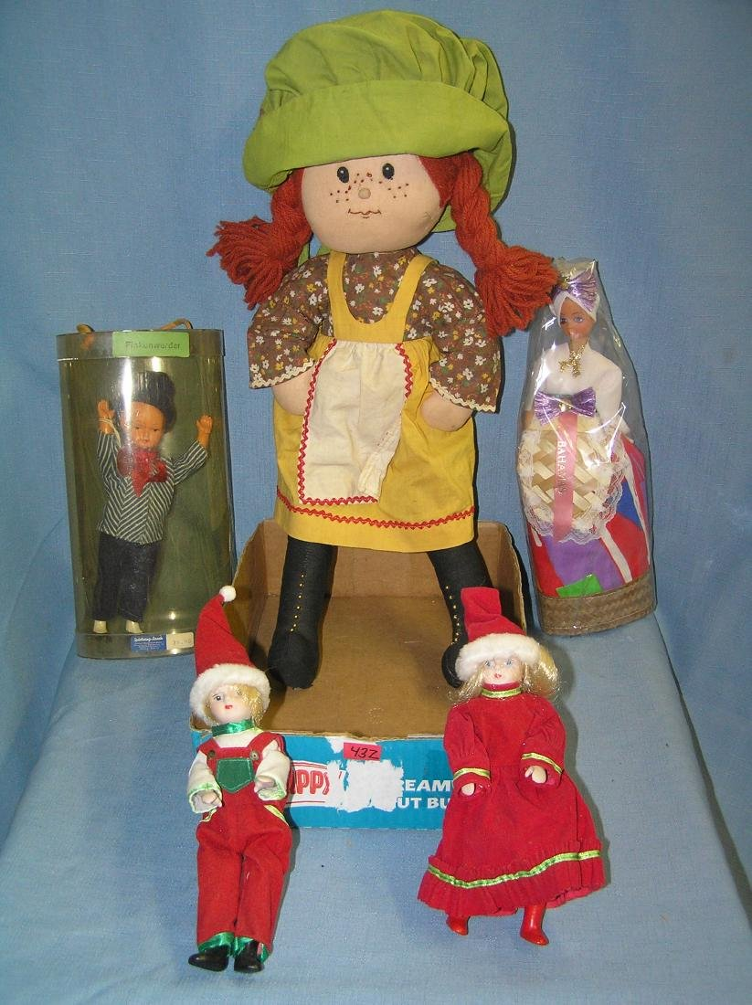 Box full of collectible dolls