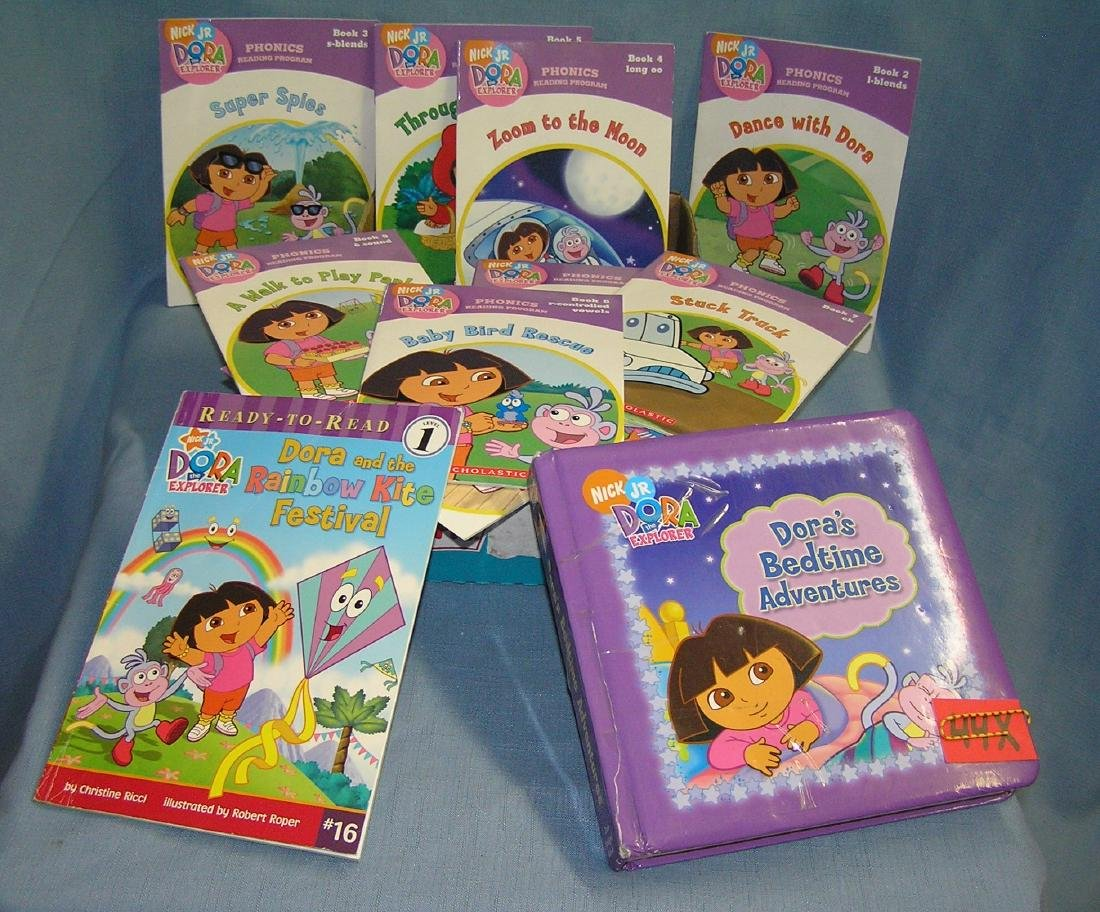 Box full of vintage Dora the Explorer children's books