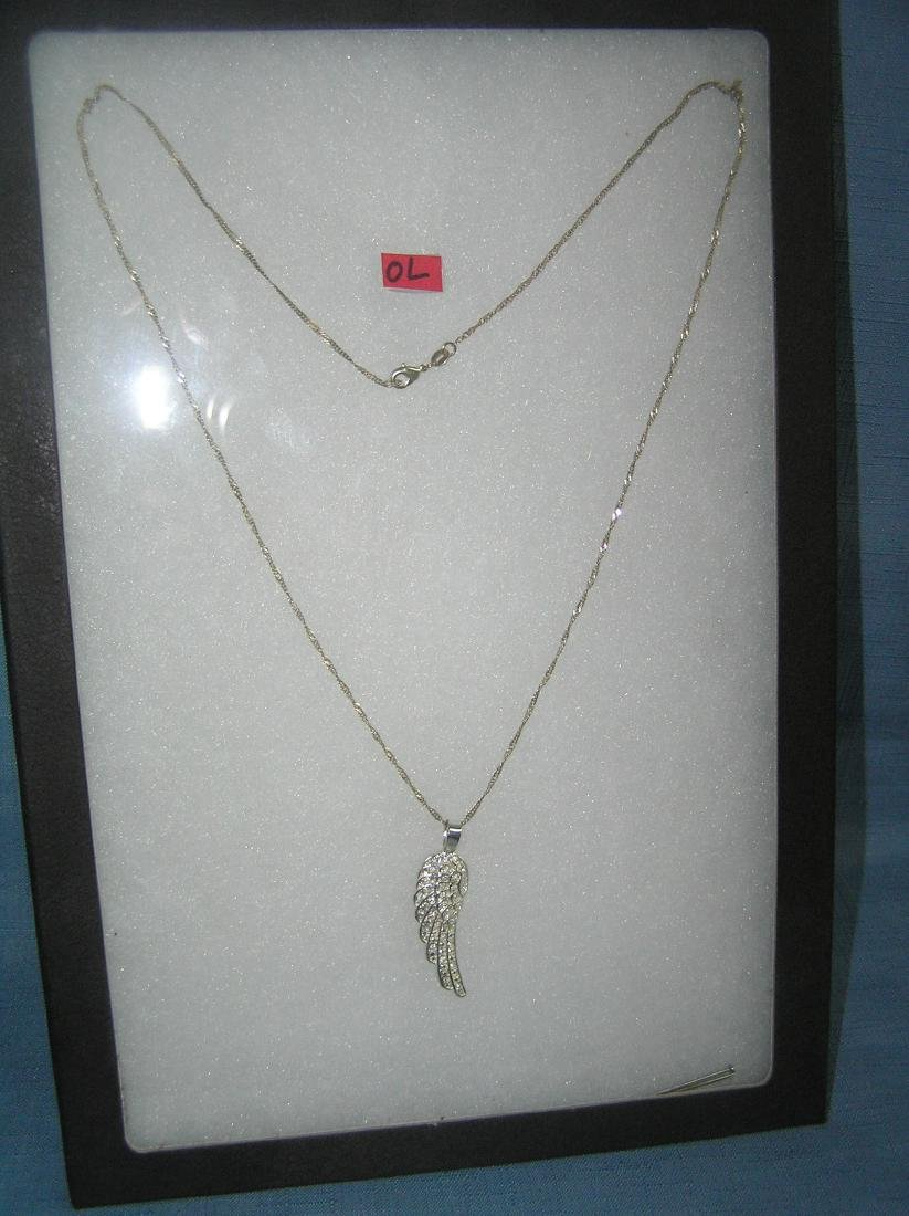 Sterling silver necklace with leaf style charm