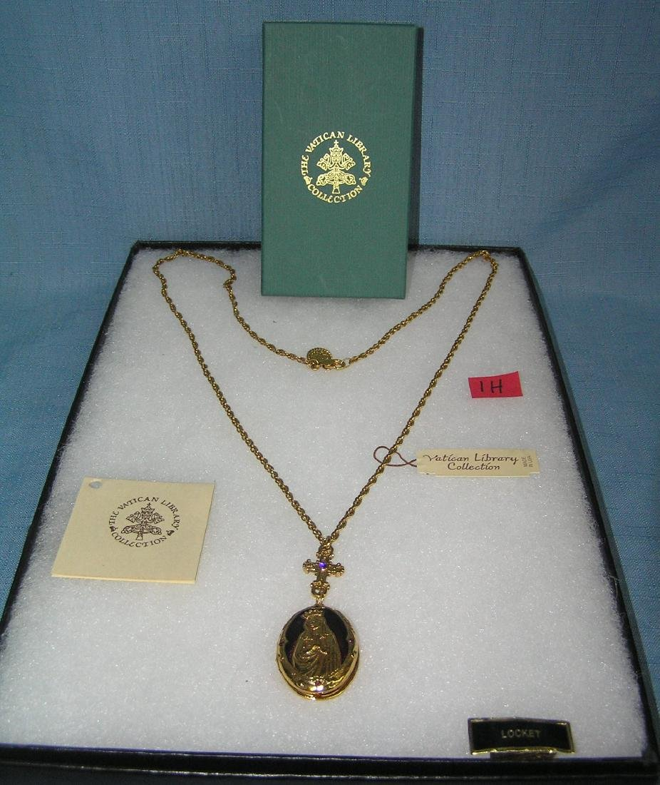 Gold toned Blessed Mother necklace with locket