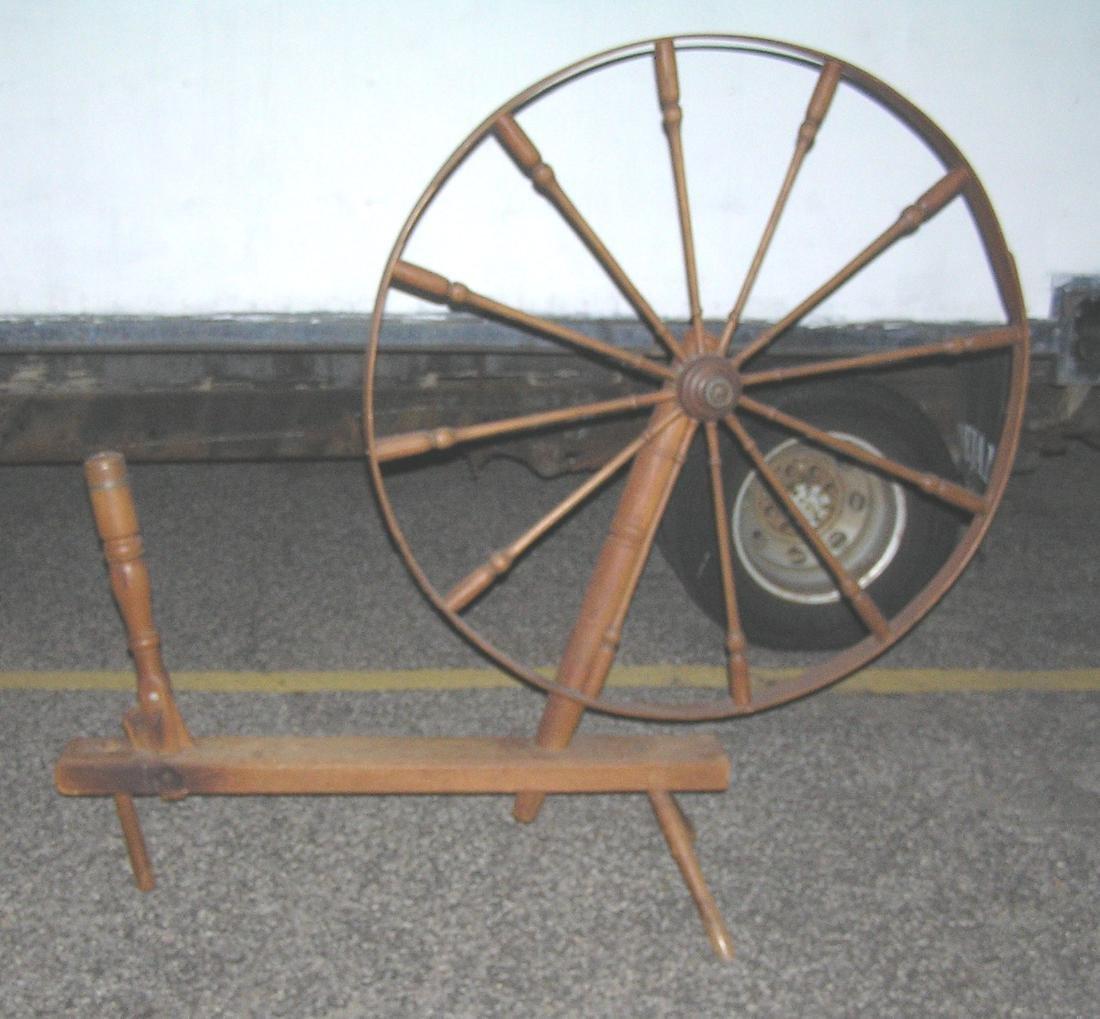 Large antique spinning wheel circa 1850's