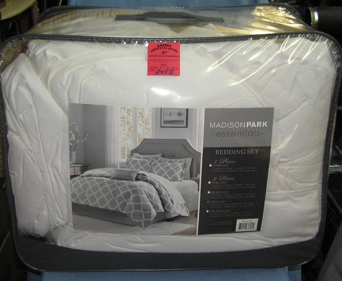Large bag full of bedding, comforters and more