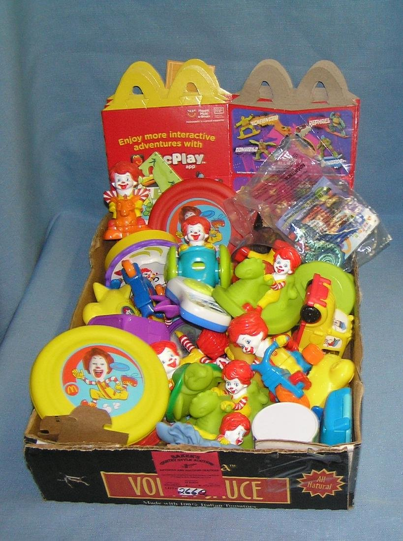 Box full of vintage fast food collectible toys