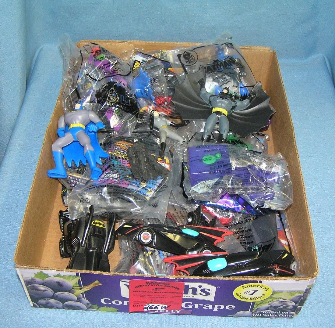 Box full of vintage Batman collectible toys