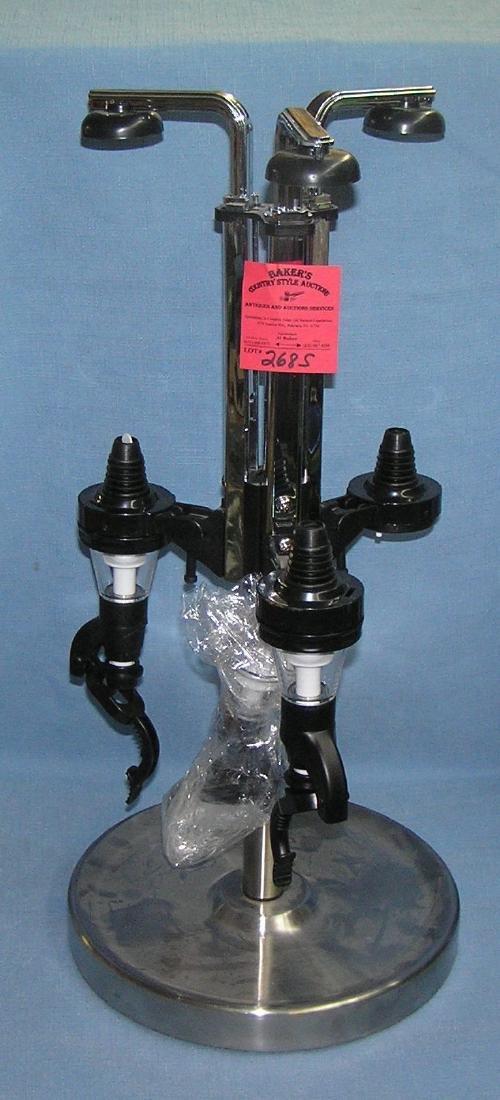 Modern wine bottle holder and dispenser