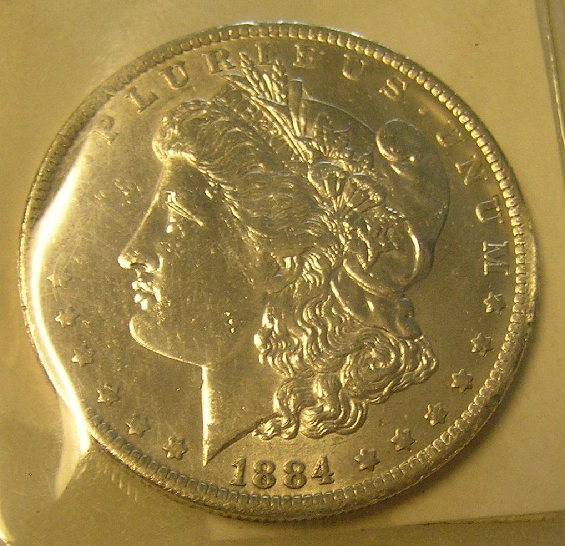 1884-O Morgan silver dollar in AU condition