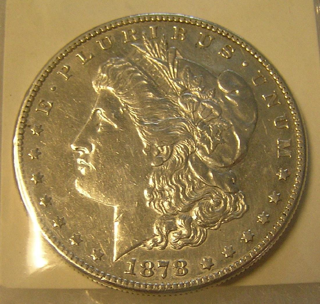 1878S Morgan silver dollar in AU condition