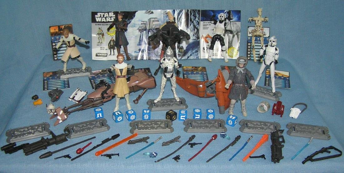 Star Wars action figures, vehicles, stands and