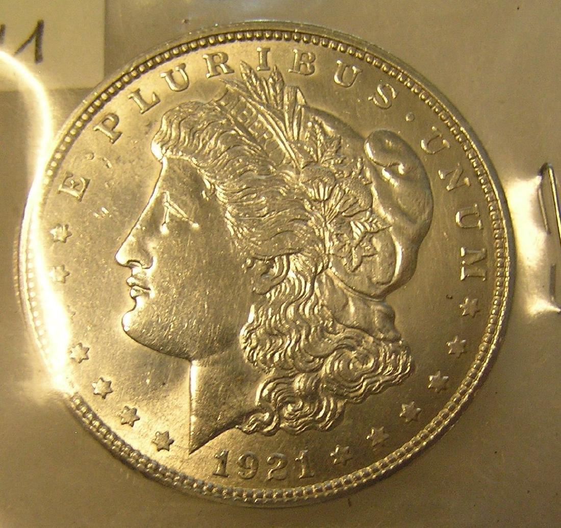 1921D Morgan silver dollar in AU condition