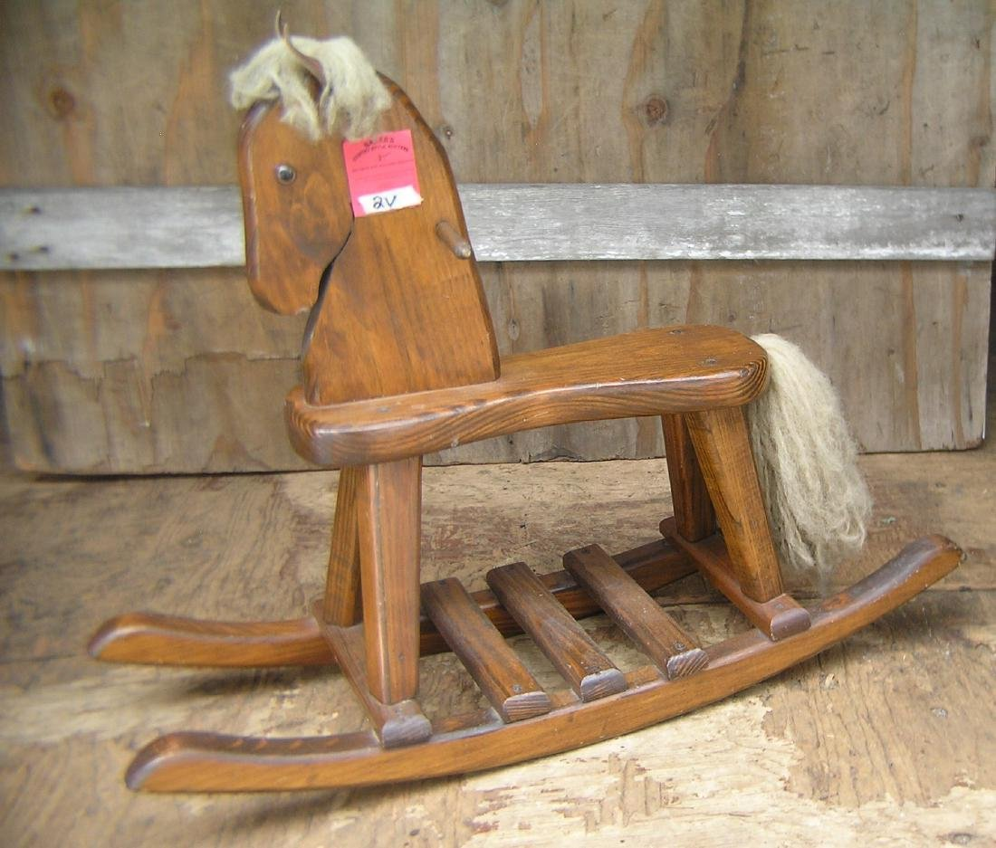 Wood, leather and mohair rocking horse with glass eyes