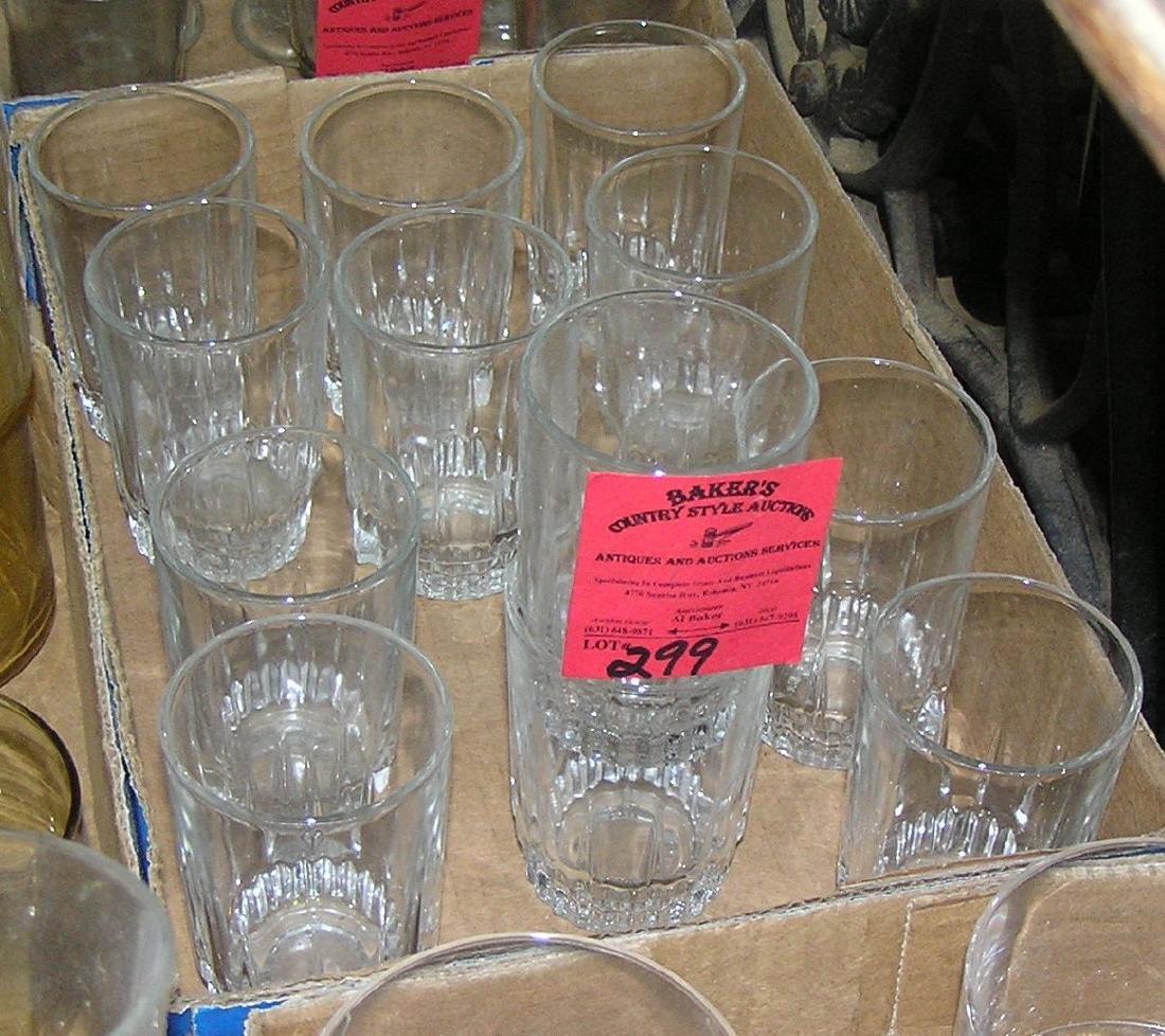 Box full of vintage juice glasses