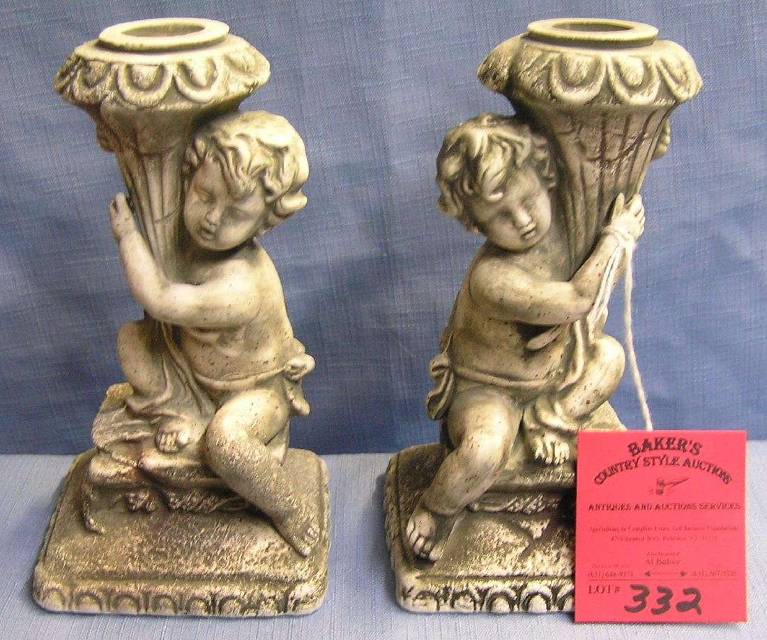 Pair of Cherub decorated candle holders