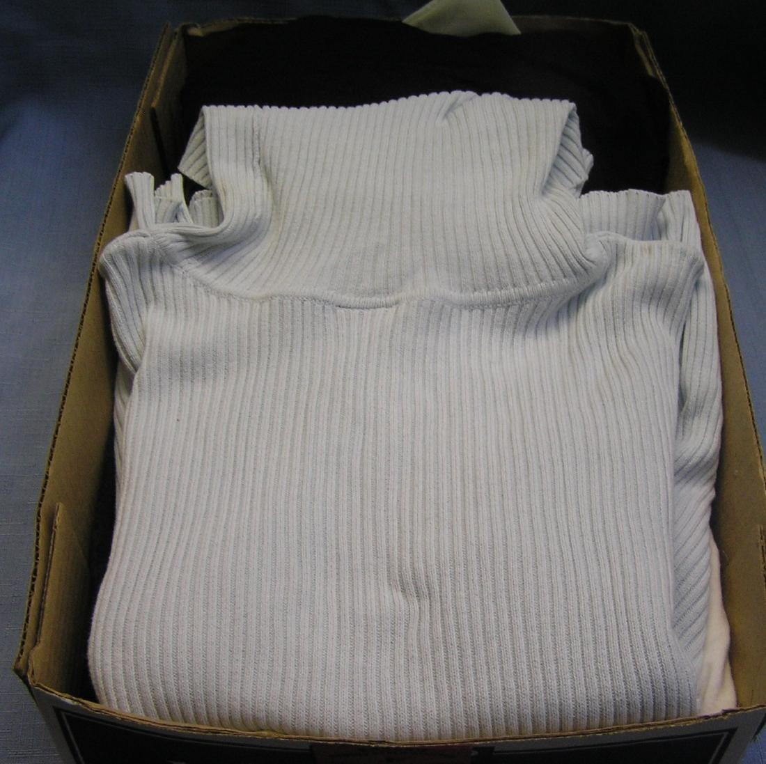 Box of quality modern shirts and turtlenecks