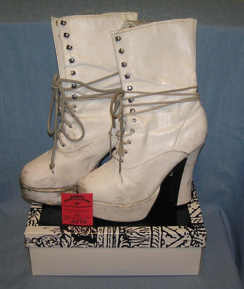 Pair of white size 9 high top platform shoes