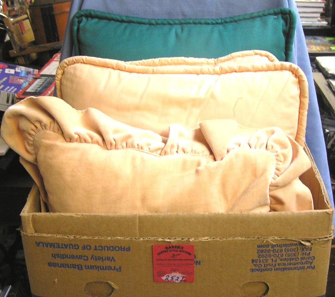 Box full of vintage pillows